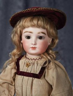 "An Outstanding French Bisque Bebe ""H"" by Halopeau in Fine Early Costume 28,000/38,000 Auctions Online 