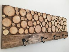 "Wood Slice Art Coat Rack - Make a statement with this stunning piece of art that has a dual function.  Quit hanging your coat on the treadmill and put it in place with this hand made coat rack.  Each rack is hand made using reclaimed wood and will have some slight variations in appearance, but size will always be the same.  Measures 36"" x 12"" (1 3/4"" deep not including hooks).  $74.99"