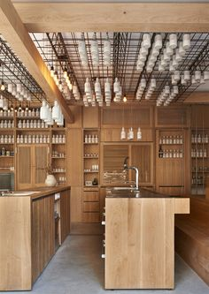 a place for everything / wooden kitchen organization / Gamsei Cocktail Bar by Buero Wagner