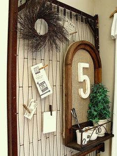 """""""Bulletin Board"""" using old spring from a crib. Great repurpose for all those drop down cribs you can no longer re-sell."""