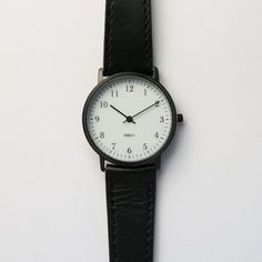 I'd like the brass w/ brown leather band, avail from Canoe or MOMA online.