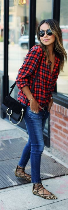 Julie Sarinana keeps it casual in a plaid shirt, skinny jeans, and funky leopard print pumps.
