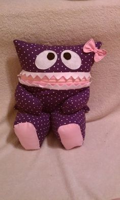 Purple with White Polka Dots Pajama Eater Pillow Pal Monster with Pink Feet and Bow. $27.50, via Etsy.