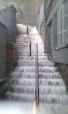Maybe more unbelievable than uh-azing! Stairs in Newcastle, UK temporarily converted in waterfall feature by Lovely English Summer Natural Phenomena, Natural Disasters, I Love Rain, Waterfall Features, Foto Fun, English Summer, Rain Storm, Stairway To Heaven, Amazing Nature