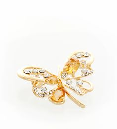 Shades of warm amber and soft yellow gold bring out the natural glow of this beautiful brooch.
