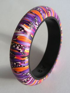Orange and Purple Stroppel handmade polymerclay bangle via Etsy