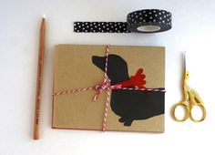 """$5 Eco-friendly, block-printed Dachshund holiday card (or set of 6 for $18). Black or Red. Blank inside for your personal message. Back: logo stamp. Size: A2 4.25"""" x 5.5"""" Carefully packaged in a clear sleeve and gift wrapped to ensure a safe arrival. All products are block-printed by hand. These cards are perfect for framing as a """"mini print"""" and all sales support animal rescue! https://www.etsy.com/listing/166447677/dachshund-holiday-card-or-set-of-6-eco?ref=shop_home_feat_2"""