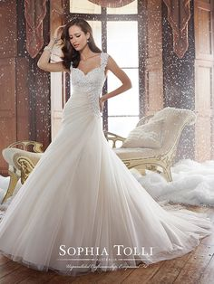 Sophia Tolli 2015 Fall Wedding Dresses - Draped to enhance a woman's figure, this asymmetrically dropped waist misty tulle A-line gown highlights many signature Sophia Tolli details. Sidney features layered Guipure lace with delicate hand-beading throughout the sweetheart bust and side of the bodice. Matching lace slight cap sleeves create an eye-catching keyhole back finished with a corset and chapel length train. #weddingdresses #weddinggown #wedding #dresses #gown #bridal #love