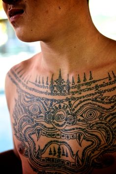 Young novice monk with a Hanuman Sak Yant (sacred thai tattoo)