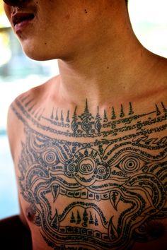Young novice monk with a Hanuman Sak Yant (sacred thai tattoo)