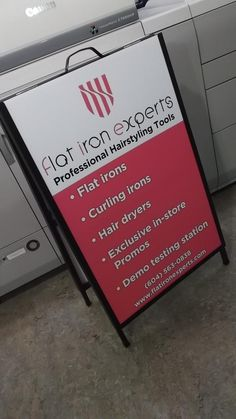 Metal A-frame sidewalk sign completed for Flat Iron Experts.