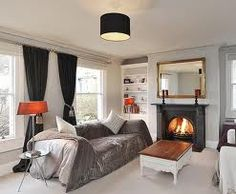 modern country interior fireplace and windows