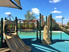 Slides on the playground for big kids at Half Moon Park in Eastvale, California. http://youreastvalerealtor.com/eastvale-parks/