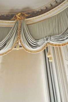 Beautiful drapes. Classical swags.  Curved room.  #InteriorDesign Solution. #Traditional
