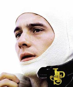 Ayrton Senna putting on his Balaclava