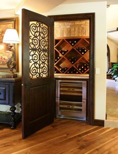 A wine closet, or a butler's pantry with room for wine storage and a wine refrigerator.     One day, I will have something like this in my house. I wish I can have this in the apartment, but my little wine section for now will do.