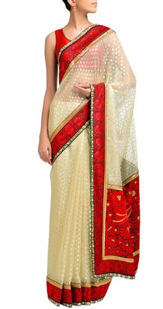 Sabyasachi Ivory woven silver buti and red bird pallu sari.