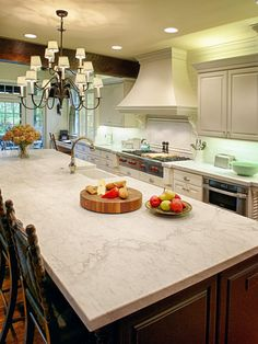 This cottage-chic kitchen features a spacious island perfect for entertaining with a buffet or prepping meals.