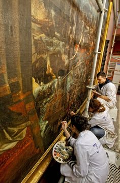 """Revelation to St. Pius V for victory of the Holy League at Lepanto"" restoration at the Naval Museum. A team of three restorers are adding color and shapes to the painting as groups of visitors pass in front of this massive (300 x 536 cm) canvas too large to move to a workshop. #arthistory"