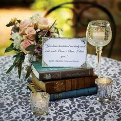 """Love story"" using old books centerpiece for a wedding. Use quotes or include how the couple met, when, where. Great conversation starter.:"