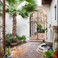 Houzz. Wonderful fountain and gate