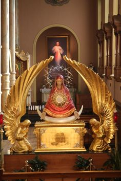 "Monstrance of Our Lady of the Sign, St. Stanislaus Kostka Church, Chicago ""May I never leave You there alone but be wholly present, my faith wholly vigilant, wholly adoring and wholly surrendered to Your creative action""- Blessed Elizabeth of the Trinity"