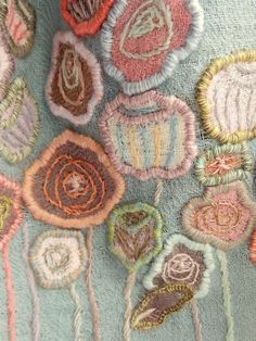 18 x 52 inch wool voile scarf hand embellished with flowers in various pastels.