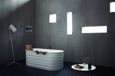Agape Vieques bathtub from steel with wooden backrest and shelf. Superb redesign of the old tin tub.