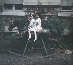 Two Girls on a Rocking Horse