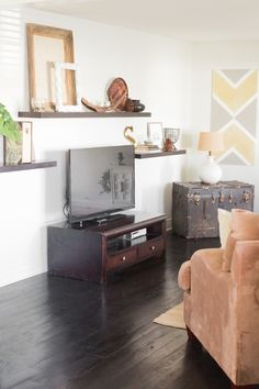 "Your TV is inevitably going to be a focal point, but don't allow the entire room to revolve around it. ""Too often people feel the need to arrange an entire room over TV placement, especially in the bedroom,"" says Leigh. Her solution? ""Try placing furniture to encourage interaction and conversation instead."" Source: Jordan Brittley via Style Me Pretty"