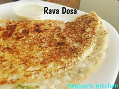 Rava dosa  is thin, fluffy and lacy crepes made with a batter of rice flour, maida (all purpose plain flour), semolina and water along with cumin seeds, salt, diced onions, ginger, chopped coriande...