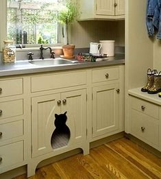 Cabinet with cutout for cat litter box | cat cut-out in sink base cabinet, laundry room, hidden cat litter box