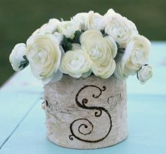 Birch bark vase! I have one, never thought of being creative on it!