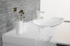 The modern lines of the Cadenza washbasin are both practical and attractive . The compact washbasin with its accompanying furniture gives a generous basin, show-casing its asymmetric design beautifully in the bathroom.