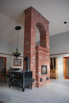 Masonry Heater Association News - The Heater Mason's E-Zine Stove Fireplace, Fireplace Design, Outdoor Wood Furnace, Brick Archway, Tyni House, Delta House, Brick Masonry, Brick Construction, Rustic Patio
