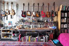 Peter's extensive guitar collection is displayed on the metallic wall. The blue meditation cushion at right and the Moroccan rug were acquired through Craigslist. Beautiful Home Designs, Beautiful Homes, Decor Interior Design, Interior Decorating, Meditation Cushion, Guitar Collection, House Tours, Sweet Home, Metallic