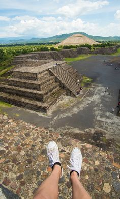 Sitting on top of Pyramid Of The Moon in Teotihuacan, Mexico City.
