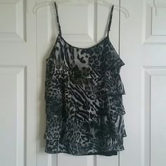 Animal print ruffle cami Animal print ruffle cami in great condition! Adjustable straps. Fits small to medium. New York & Company Tops Camisoles