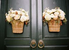 flowers in wicker baskets on church doors, captured by Ali Harper