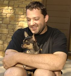 Tony Stewart makes sure to keep his dog close during an SI photo shoot in his hometown of Columbus, Ind. #NASCAR