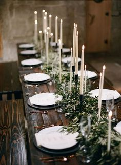 Green Bohemian Wedding Reception Centerpiece Photographer: Bryan N. Miller Photography, Via Rustic Events; Rustic boho chic greenery wedding reception centerpiece with black and white candles; Olive Branch Wedding, Branches Wedding, Branch Wedding Centerpieces, Long Table Centerpieces, Olive Wedding, Green Wedding, Christmas Wedding Centerpieces, Wedding Table Garland, Winter Centerpieces