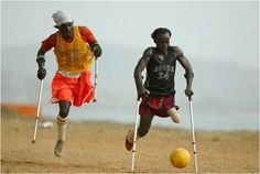 Playing soccer on sand with one leg and crutches.There are no limits to what one can achieve.  www.everyday-wisdom.com