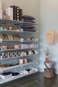 Shelcing and bookcase styling for a retail space.  I love that the space between each shelf is minimal, making it look a lot more full.