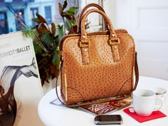 Ostrich-Embossed Shopper by Ivanka Trump.  I love this bag! It is perfect everyday for work.