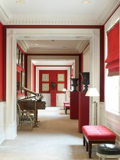 Red hallway with dentil moulding - Luis Bustamante