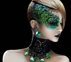 Gorgeous peacock inspired makeup enhanced with crystal accents.