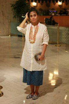 Indian Kurti and jewellery with western skirt.