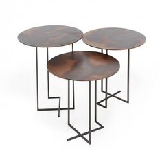 Urushi Side Tables  Ancestral elements like lava and metal are reinvented in this modern design. Set on an architectural, hand-welded metal frame, each tabletop features a unique patina. Handcrafted in Italy, this one-of-a-kind piece exists at the apotheosis of design, industry, and craftsmanship.