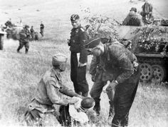Waffen SS personel helps soviet wounded and POW
