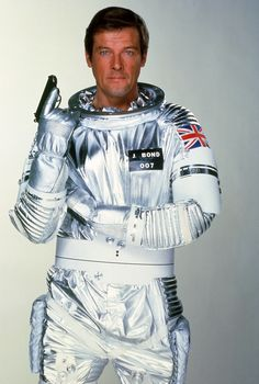"Roger Moore is James Bond 007 in ""Moonraker"" (1979) . Suave, tanned, and wrapped in a tin foil boilersuit. Spacewear from the future."